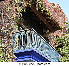 Overgrown Blue Balcony - An aged and weathered blue balcony...