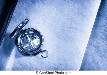 Vintage compass on blank paper