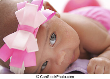 baby posing on a cloth diaper - one portrait of a young baby...