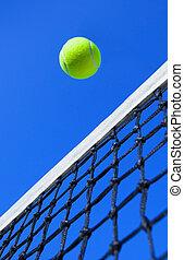 Tennis balls on Court - tennis ball on a tennis court