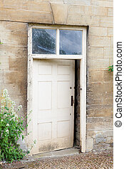 Old external door in a stone wall - Weathered exterior door...