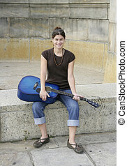 woman with guitar - full length portrait of one woman...