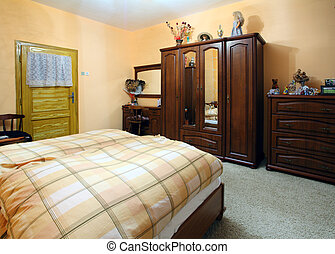 Orange Bedroom with a double wood bed