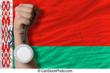 Silver medal for sport and  national flag of belarus