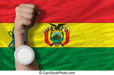 Silver medal for sport and national flag of bolivia -...