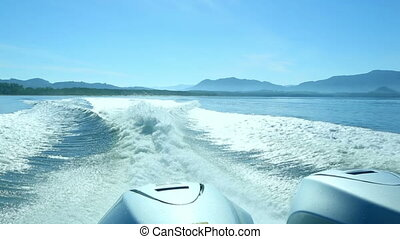 Trace of a speedboat. - View from the rear of moving...