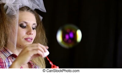 Soap bubbles - Young woman blowing soap bubbles