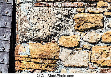 Medieval fortress stone-brick rampart with heavy...