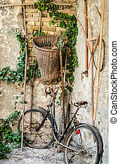 Antique bicycle in a rural alley