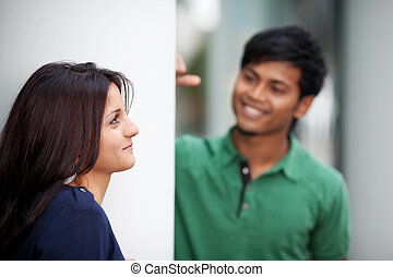 young couple flirting - portrait of a young couple flirting...