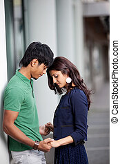 Romantic young couple holding hands - Romantic young Asian...