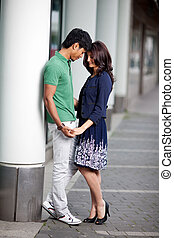 Loving couple in town - Loving fashionable young Asian...
