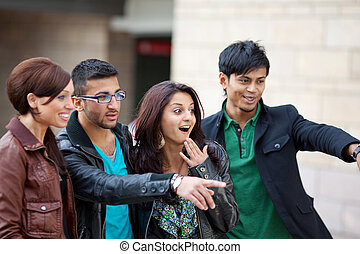 Group of friends pointing - Group of young trendy...