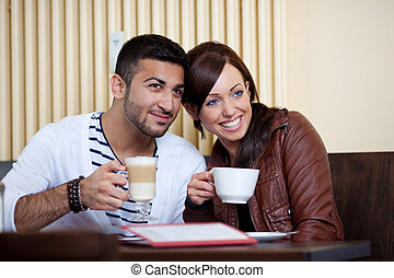 Loving Asian couple in a restaurant