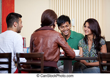 Gossip among friends - Talking in a coffe shop between good...