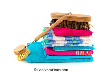 scrubbing brushes and dish clothes to clean up
