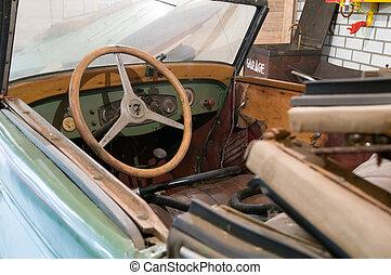 Damaged oldmobile - damaged oldmobile in the garage