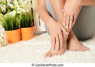 Female hands and feet with manicure and a pedicure - Female...
