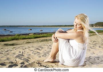 Woman in white dress feeling wind flow