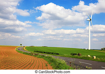 Wind turbine on spring field