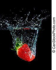 Splashing Strawberry - Strawberry in water with bubbles on...