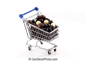 Buying too much chocolate - Shopping cart full of chocolate,...