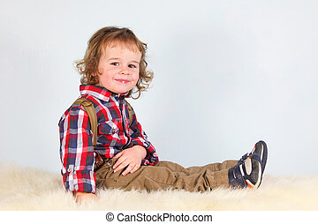 Little boy in rural clothes