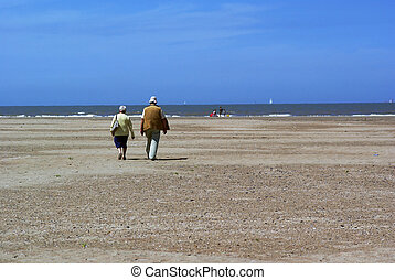 Elderly couple on the beach.