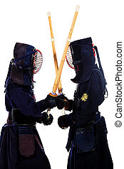 asian martian arts - Two kendo fighters are fighting with...