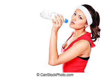 clear water - Sportive young woman drinking clear water...