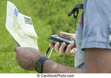 Man with gps and plan - Man holding a GPS receiver and plan...