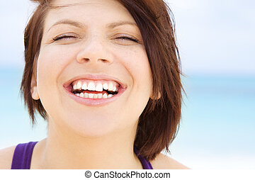 happy woman face - bright closeup picture of happy woman...