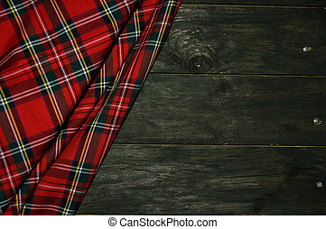 tartan textile on wooden background