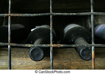 Dusty Wine Bottles - Wine bottles found in a dank cellar;...