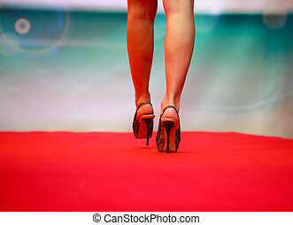 Model during fashion show - Model walkink on runway during...