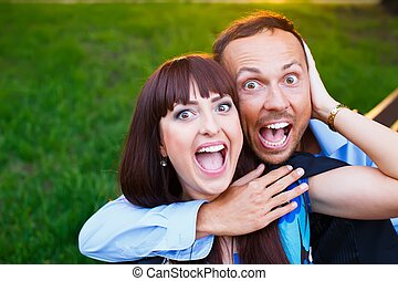 Happy smiling middle-aged couple outdoors