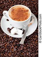 Cup of coffee surrounded by cofffee beans - Cup of fresh...