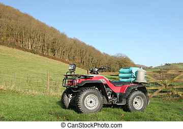 Quad Bike - Quad bike standing in a field in rural...