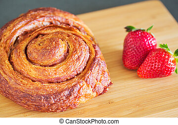 Delicious Cinnamon Roll Sticky Bun with Strawberries