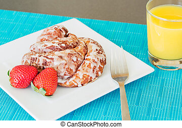 Delicious Cinnamon Roll Sticky Bun with Strawberries and...