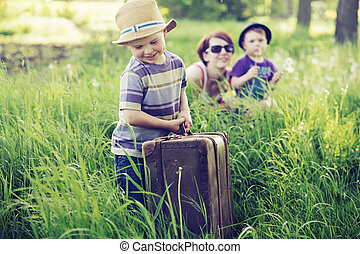 Cheerful family playing on tall grass - Cheerful family...