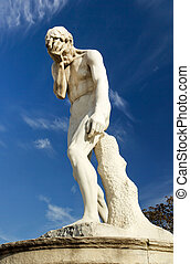 Tuileries Garden in Paris, near Louvre A facepalm statue