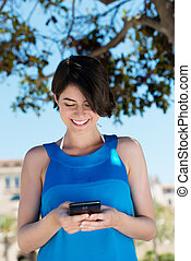 Woman texting on her mobile phone - Low angle view of an...