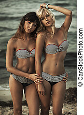 Two female friends with perfect bodies