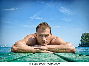 musculaire, jeune, homme, reposer, sien, menton, sien,...
