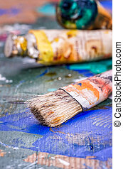 Brush and oil colors on a wooden palette