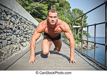 Young bodybuilder ready to sprint and run - Young, handsome...