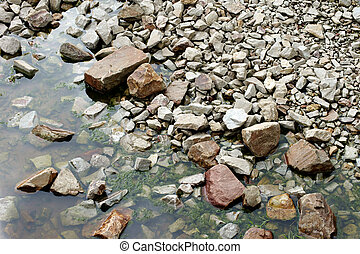 Outflow bed - The photograph of a drainage bed with boulders...