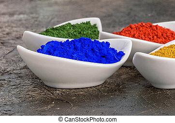 Vibrant color pigments  in porcelain bowls