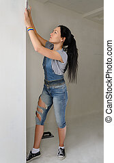 Shapely young woman redecorating her apartment - Shapely...